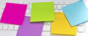 Colorful sticky notes post on white laptop's keyboard